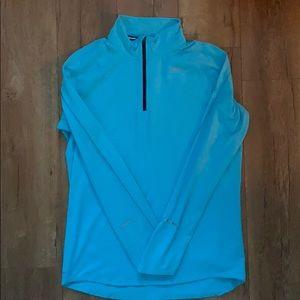 Light blue Nike DriFit sweater